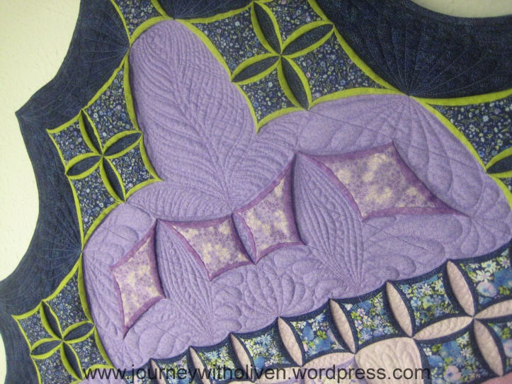 All the quilting is in the very similar colour as the background fabric - I wanted it to be there but not to overtake the design of the Cathedral windows.
