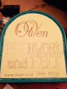 painting sign for oliven