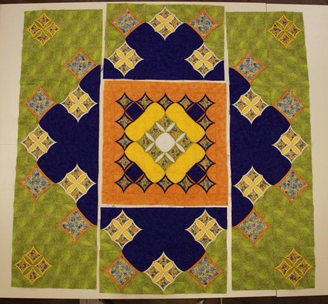Sunny garden cathedral window quilt