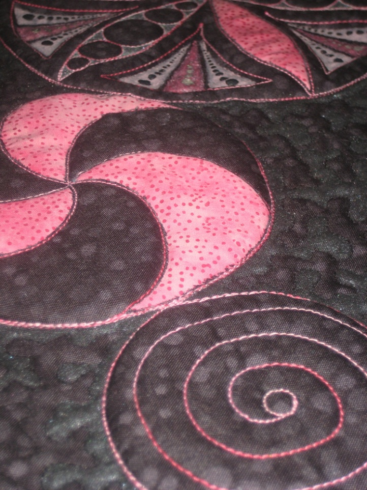 Pink and black wall hanging